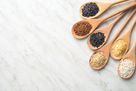 Different rice varieties on kitchen table.