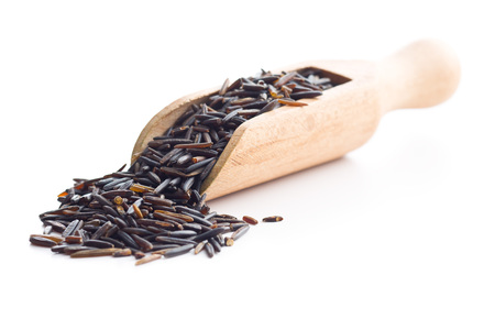 wild rice: The wild rice in wooden scoop isolated on white background.