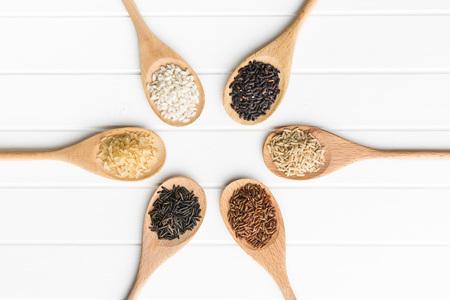jasmine rice: Different rice varieties on kitchen table. Top view.