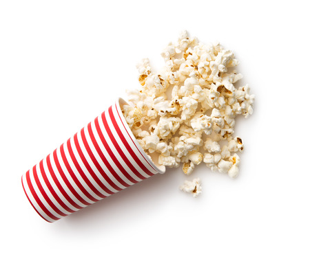 pop corn: Tasty salted popcorn in striped paper cup isolated on white background.