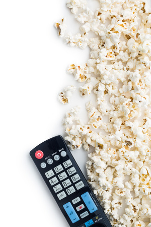remote: Tasty popcorn and tv remote control. Top view.