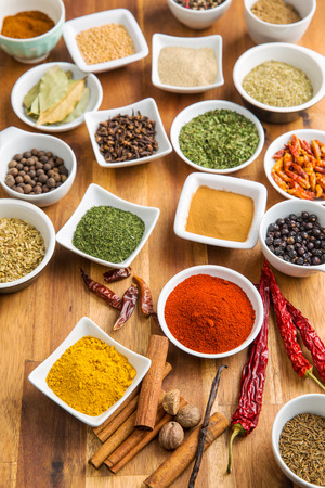 dried herbs: Various dried herbs and spices on wooden table. Stock Photo