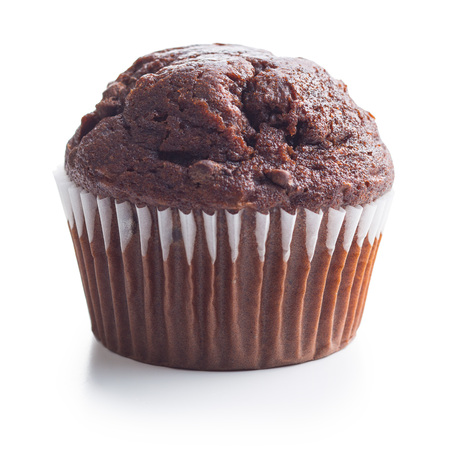The tasty chocolate muffin isolated on white background. Banque d'images