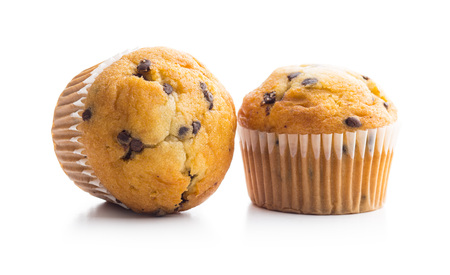 The tasty chocolate muffin isolated on white background. Stock Photo