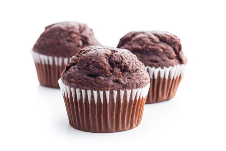 The tasty chocolate muffin isolated on white background. Foto de archivo