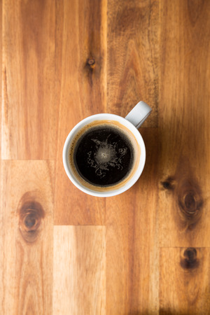 cappuccino cup: Cup of coffee on wooden table. Top view.
