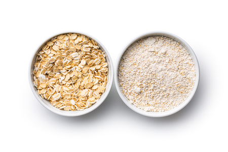 avena: Dry rolled and ground oatmeal isolated on white background.