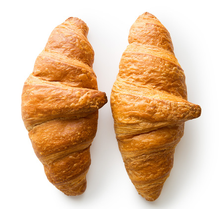 roll out: Two tasty buttery croissants isolated on white background.