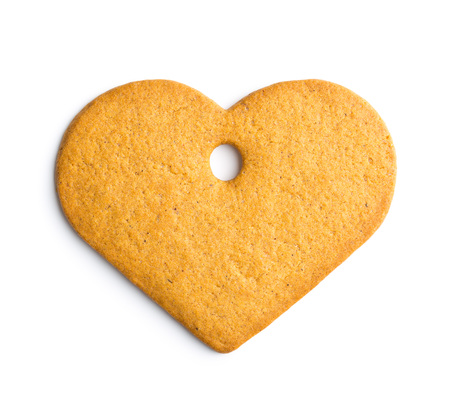 gingerbread heart: Tasty gingerbread heart isolated on white background. Stock Photo