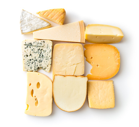 Different kinds of cheeses isolated on white background.