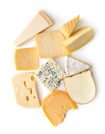 Different kinds of cheeses isolated on white background. Top view.