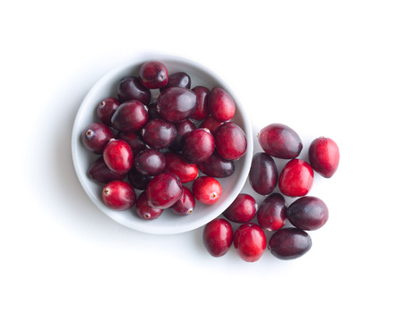 The tasty american cranberries in bowl isolated on white background. Top view. Stock Photo
