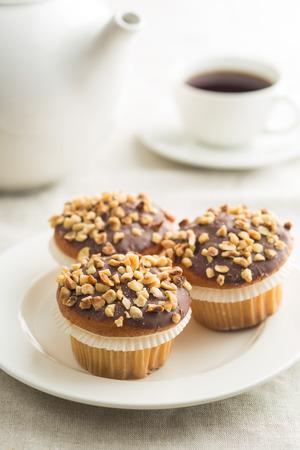 Sweet hazelnut muffins on white plate.