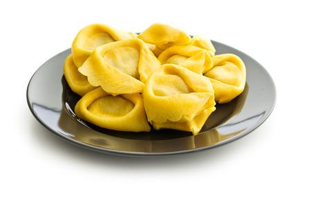 tortellini: Italian traditional tortellini pasta on plate isolated on white background.