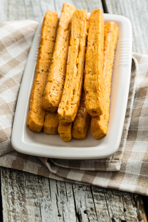 Crispy bread sticks on plate.