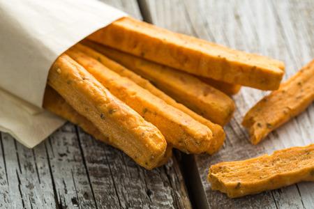 caloric: Crispy bread sticks on old wooden table. Stock Photo