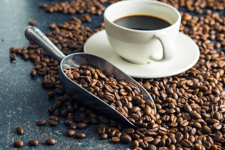 coffee beans: Roasted coffee beans and cup of coffee.