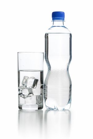 purified: Glass of pure water with ice cubes and bottle water.