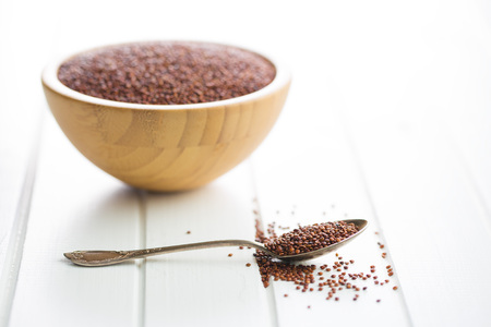 red quinoa: Red quinoa seeds in spoon.