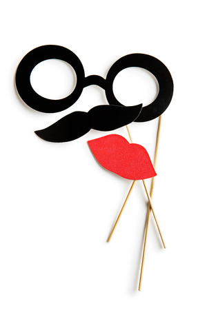 comedy: Fake lips, glasses and mustaches on sticks. Isolated on white background.
