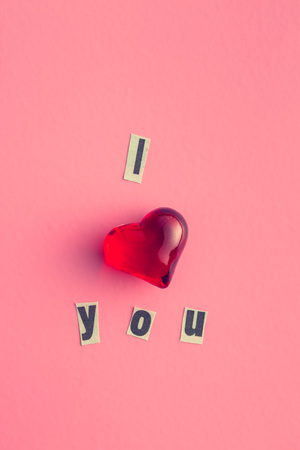 title emotions: I love you. Inscription with heart on pink background.
