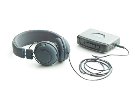 stereo cut: The vintage audio player and headphones isolated on white background. Stock Photo