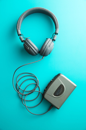 personal record: The vintage audio player and headphones on blue background. Top view. Stock Photo