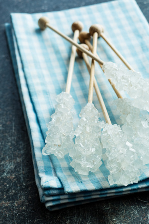 crystallized: Crystallized sugar on wooden stick on napkin.