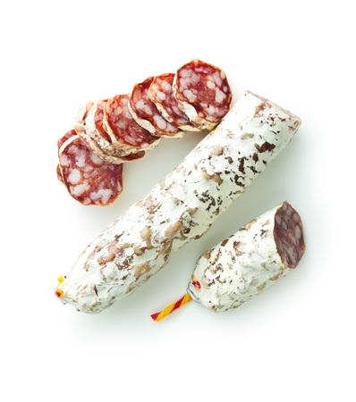 Tasty sliced salami isolated on white background.