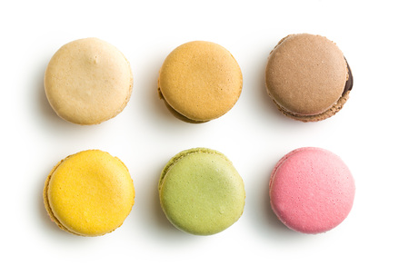 Sweet colorful macarons isolated on white background.