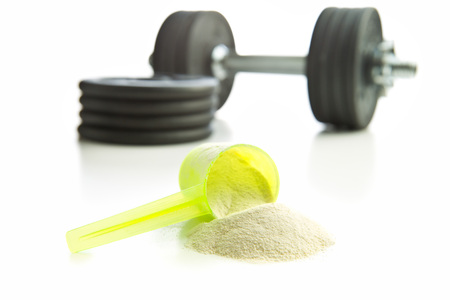 concentrate on: Whey protein powder isolated on white background. Stock Photo