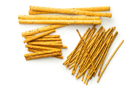Salty pretzel sticks isolated on white background. Top view.