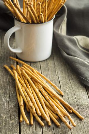 pretzel stick: Salty pretzel sticks on old wooden table. Stock Photo