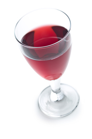 Glass of red wine isolated on white background.