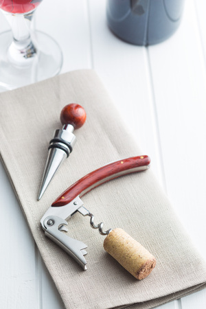 Cork and corkscrew on white table. Stock Photo