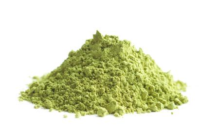 Green matcha tea powder isolated on white background. Stock Photo