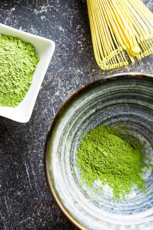 maccha: Green matcha tea powder in bowl. Top view. Stock Photo