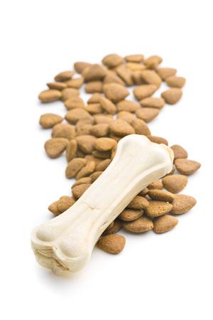kibble: Dry kibble dog food and chew bone. Stock Photo