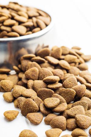 kibble: Dry kibble dog food on table.