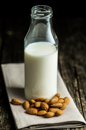vacas lecheras: Healthy almond milk in bottle. Foto de archivo