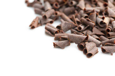 spall: Tasty chocolate curls isolated on white background.