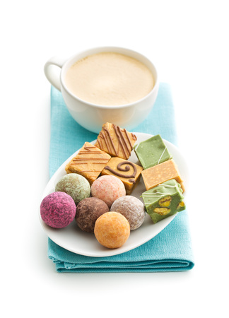 Various sweet candies and coffee cup with coffee. Stock Photo