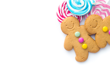 Two sweet gingerbread men and lollipops isolated on white background. Stock Photo