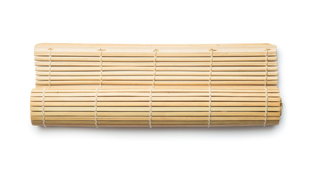 Sushi rolling roller bamboo mat on white background.