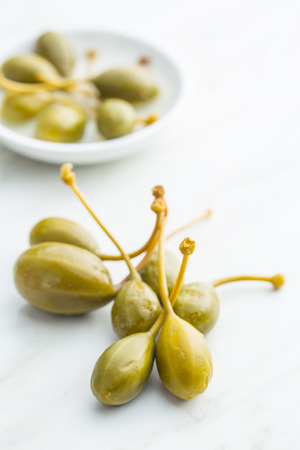 Pickled Caper Berries On Kitchen Table. Stock Photo, Picture And ...