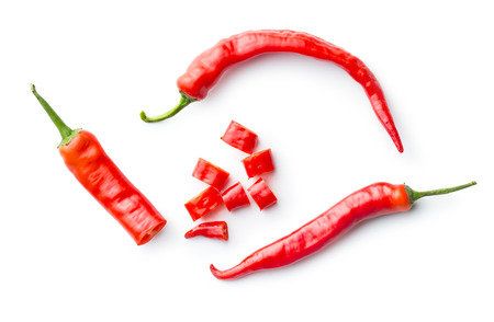 Sliced chili peppers isolated on white background. Top view.