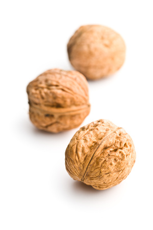 Tasty dried walnuts isolated on white background. Stock Photo
