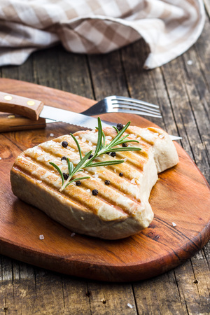 Grilled tuna steak on cutting board.