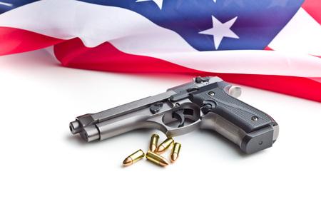 Pistol bullets, handgun and USA flag isolated on white background. Stock Photo