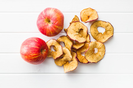 Dried apple slices on white table.